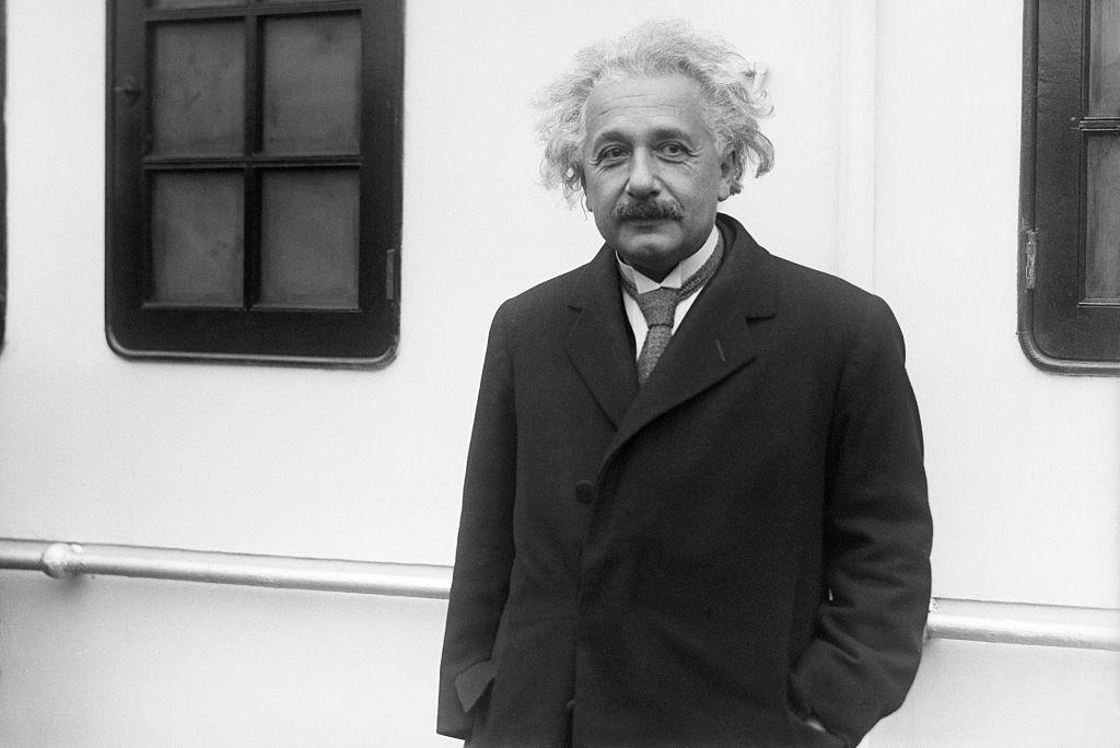 Albert Einstein standing on ship