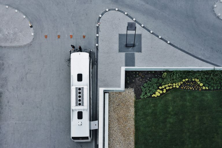 Directly Above View Of Bus Parked On Roadside