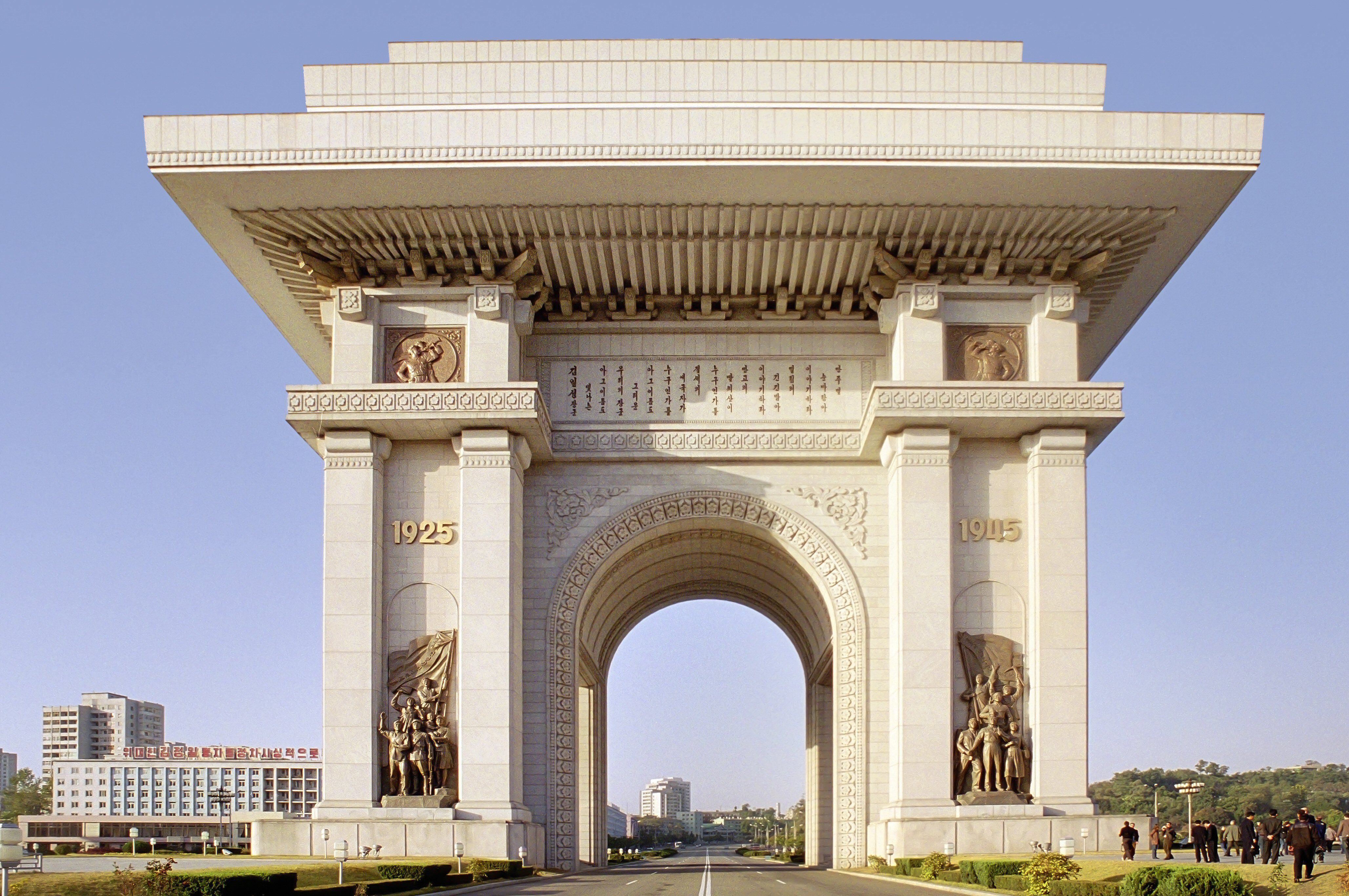 light-colored arch monument with wide overhang top