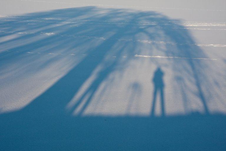 Shadows on a frozen lake