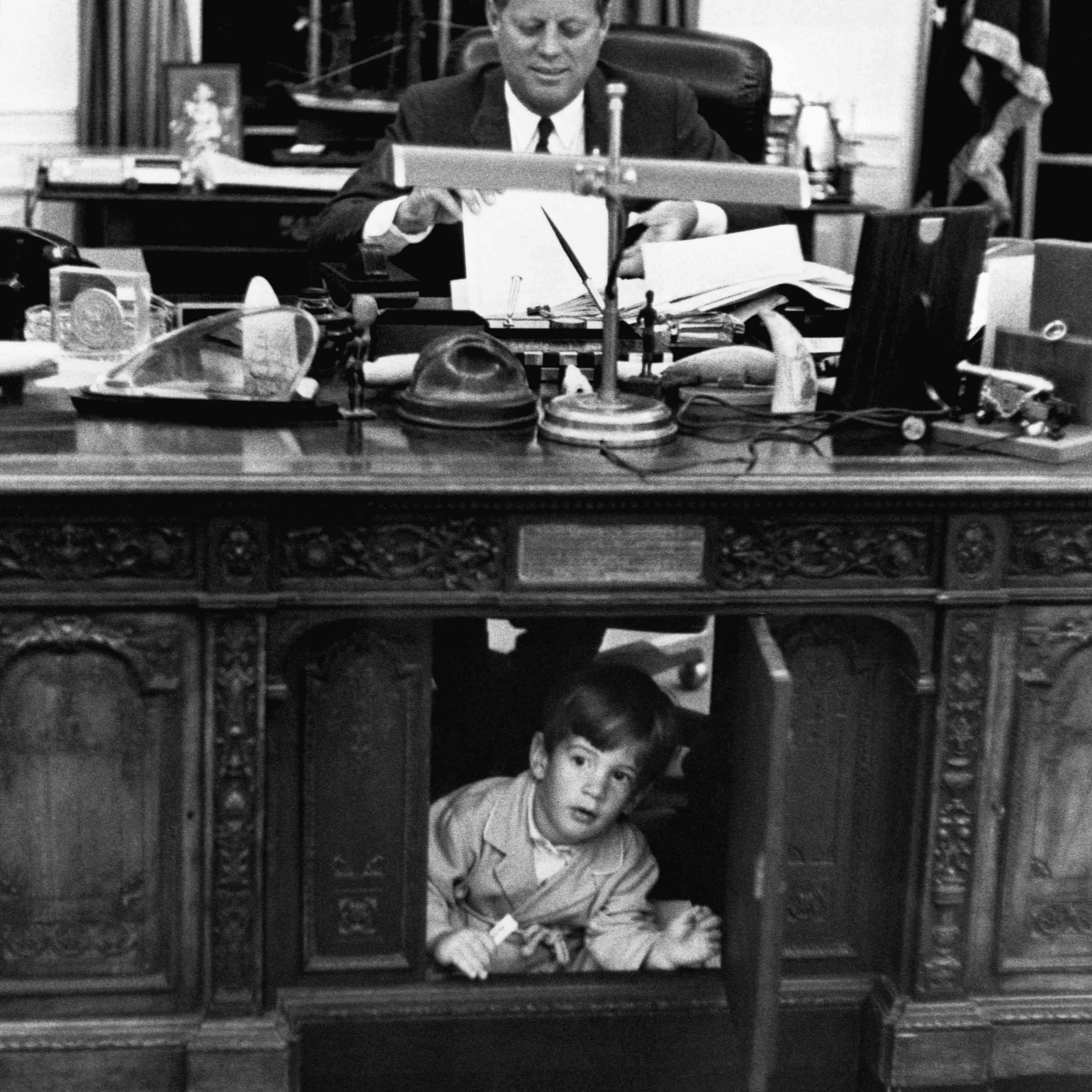 John Kennedy, Jr., exploring his father's desk