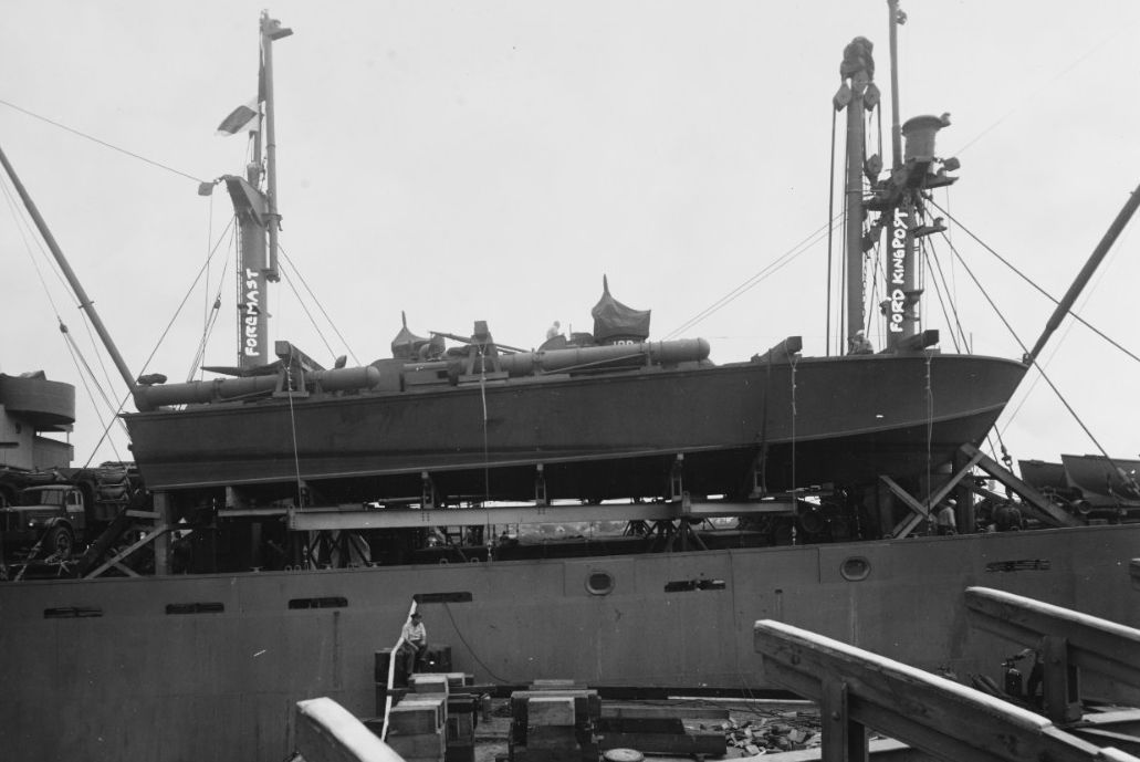 PT-109 resting on the deck of a cargo ship.