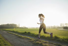 A Female Runner on a Country Road
