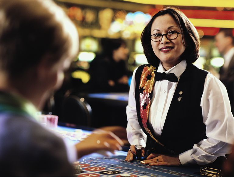 Portrait of a female croupier at a casino