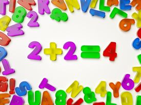 """Plastic numbers arranged to show """"2+2=4"""""""