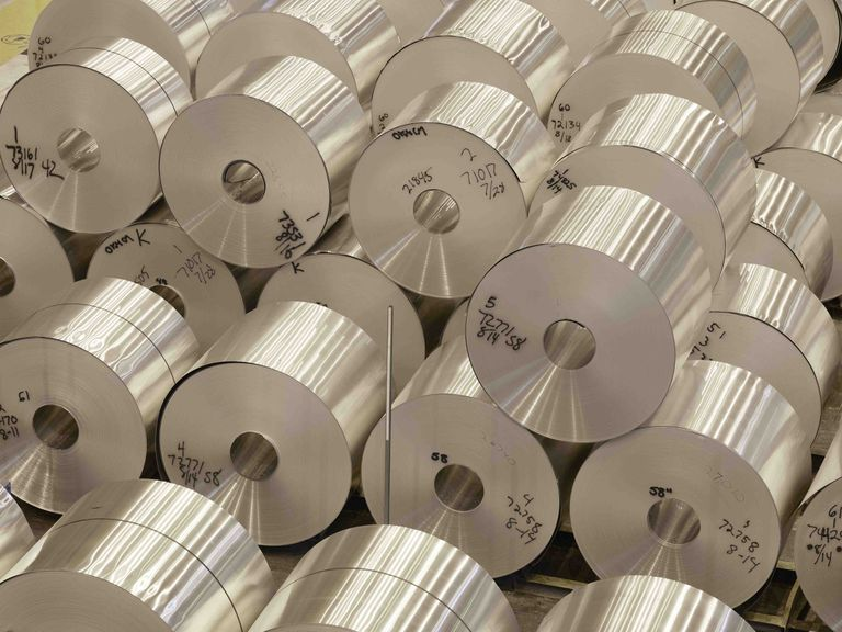 Stacked coils of aluminum sheet at the Novelis plant in Oswego, NY