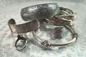 A pile of silver jewelry.