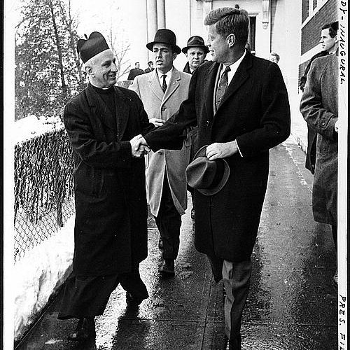 John F Kennedy shakes hands with Father Richard Casey after attending mass before his inauguration.