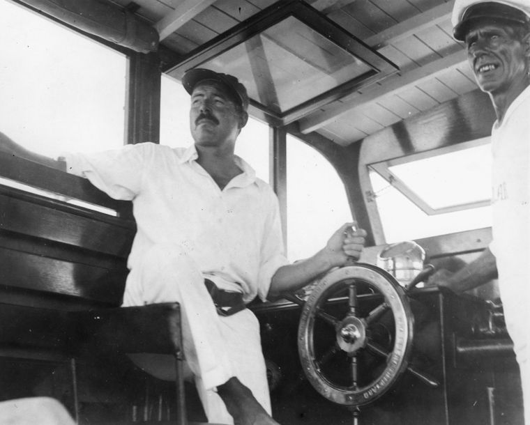Ernest_Hemingway_and_Carlos_Gutierrez_aboard_Pilar,_Key_West,_1934.jpg