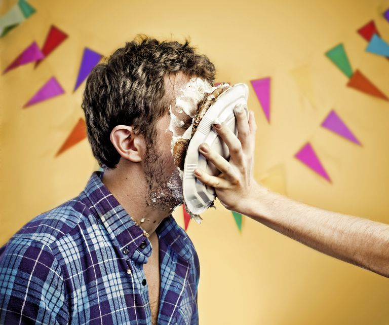 Man getting hit in face with pie