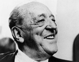 Black and white photo of elderly white man, laughing, architect Mies van der Rohe, c. 1950