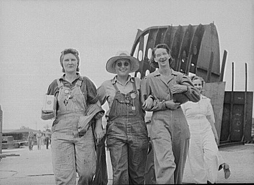 Four women leaving the Pennsylvania Shipyard in Beaumont, Texas, 1943.