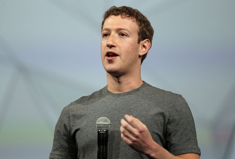 Facebook co-founder Mark Zuckerberg speaking with a microphone