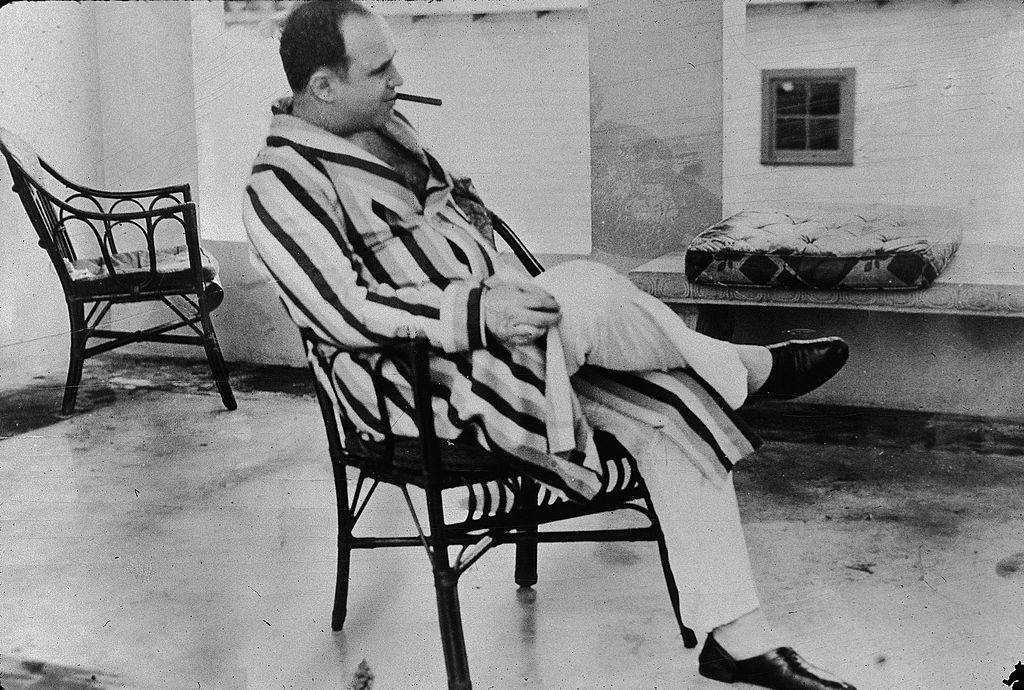 American gangster Al Capone ('Scarface') (1899 - 1947) relaxes in his vacation home, Miami, Florida, 1930.