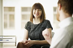 Coworkers in discussion at conference room table