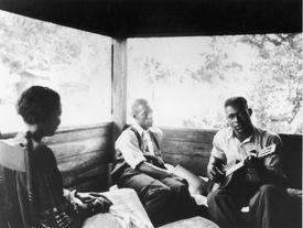 Zora Neale Hurston and friends, black and white photograph.