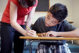 Teacher helping student in class