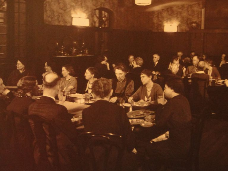 Residents of Hull House in the dining room, about 1920
