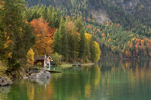 A cottage on a lake in the Bavaria Alps