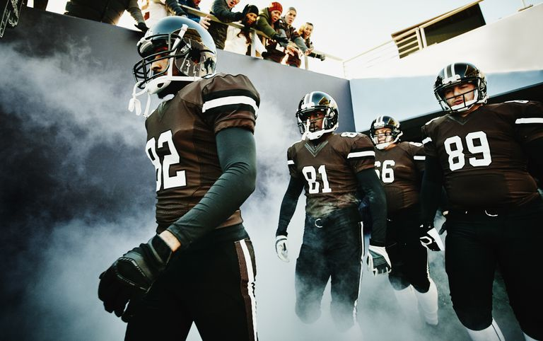 Football team walking out of stadium tunnel