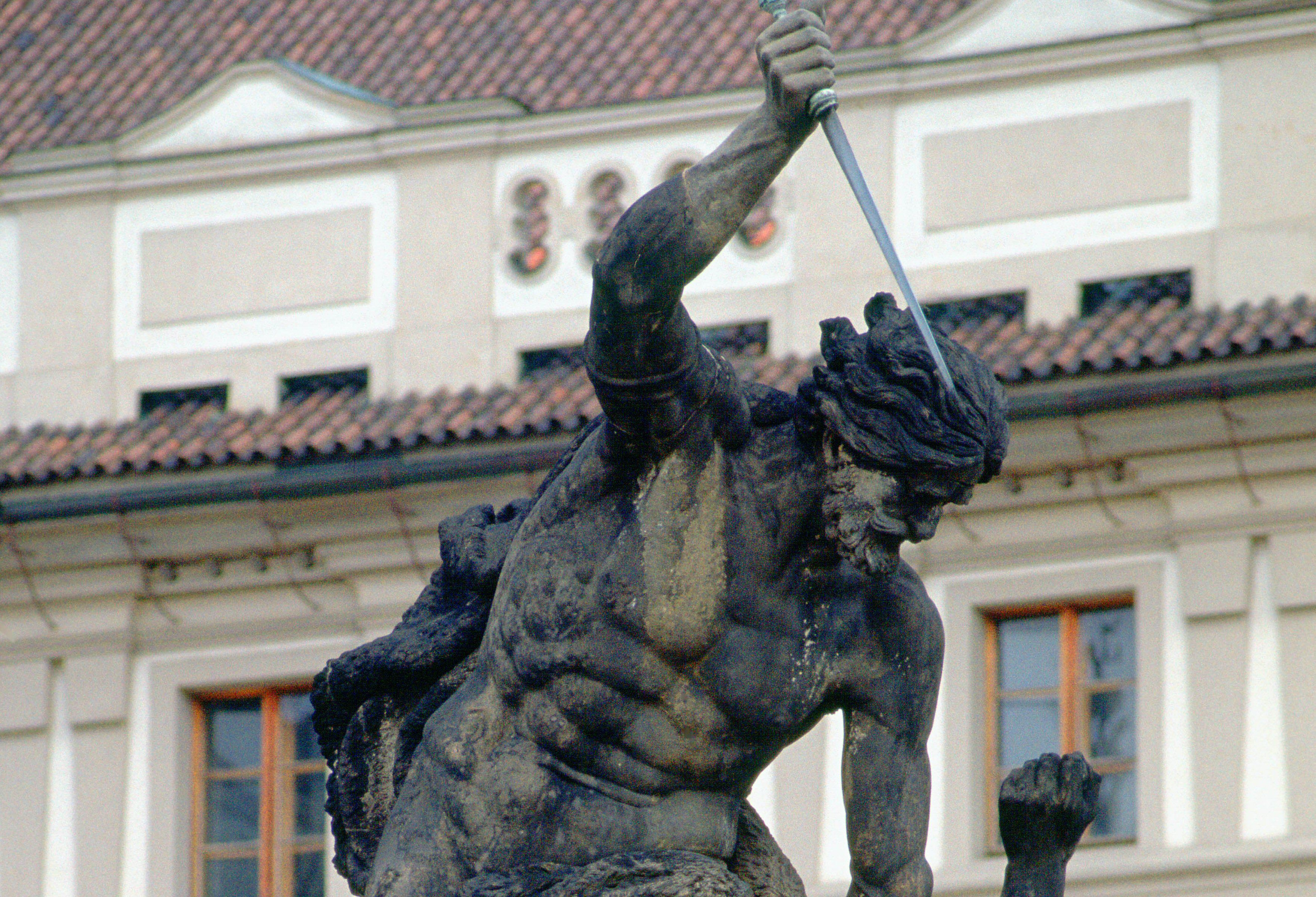 Statue in Hradcany Castle, Prague of one man about to knife another, who begs for his life