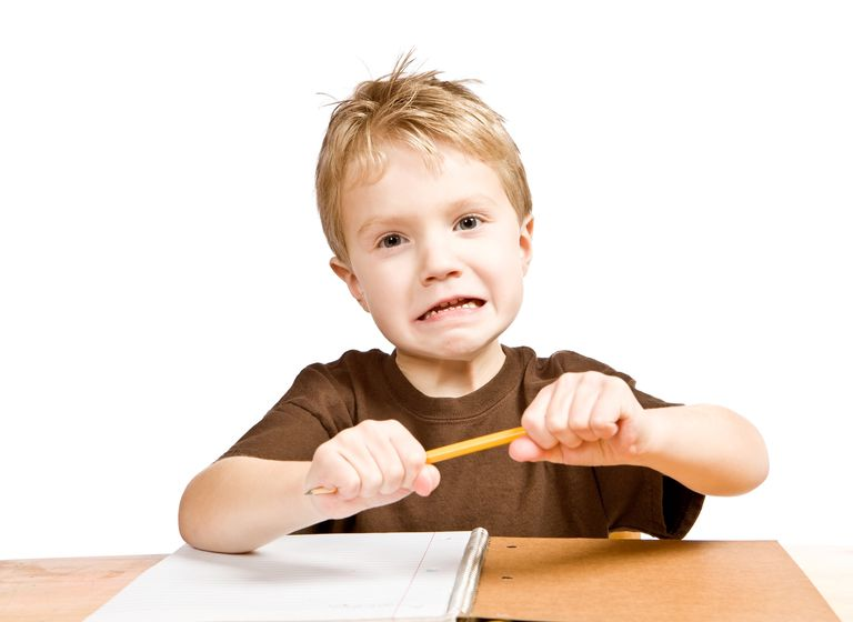 frustrated kid trying to break his pencil