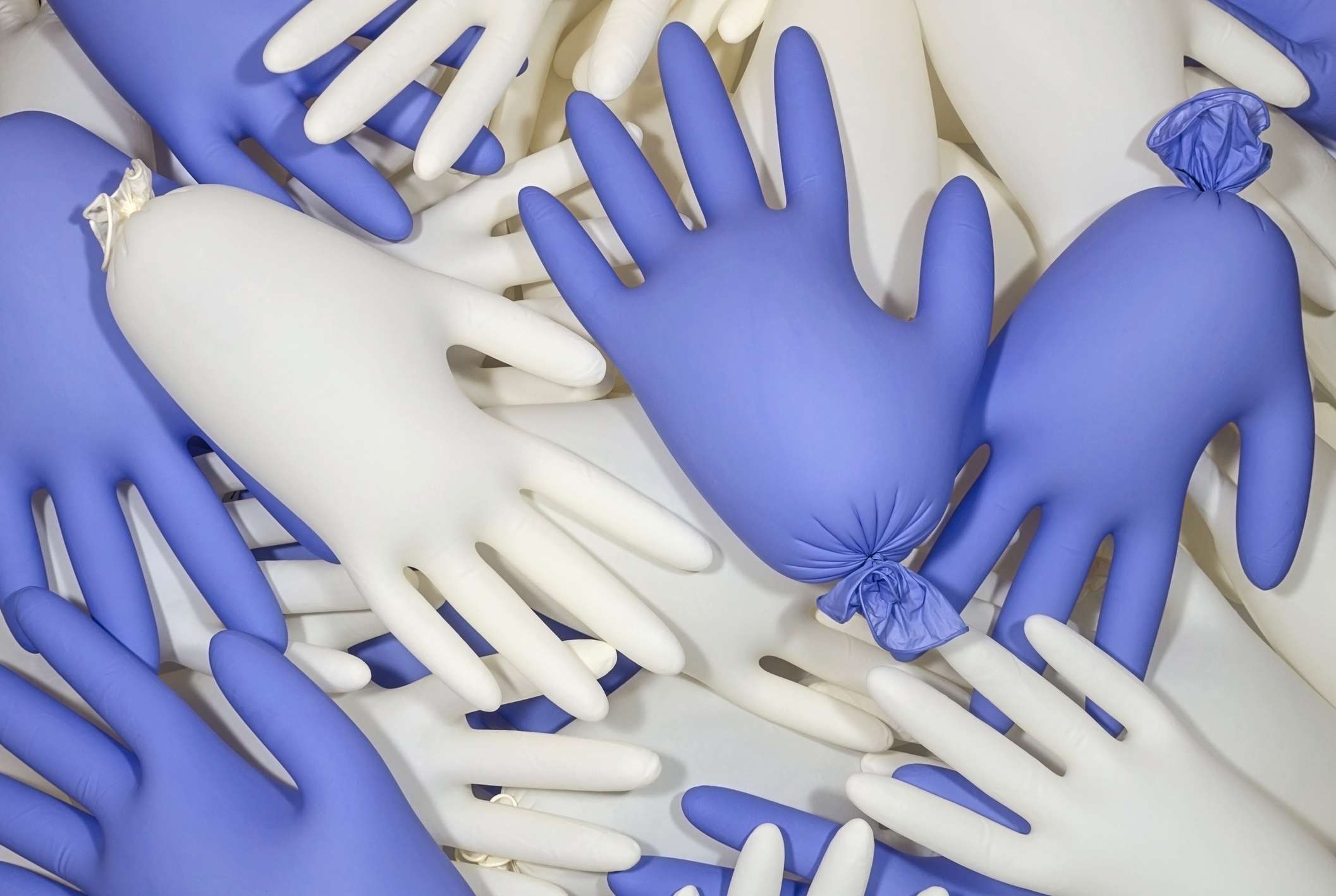 White and blue inflated medical latex gloves background