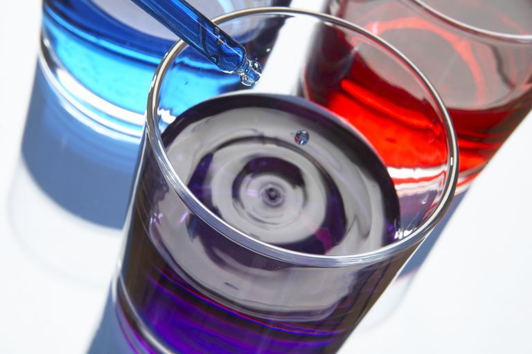 Colorful liquids in glass beakers