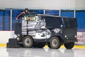 A Zamboni machine on the ice.