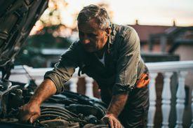 Mechanic repairing car
