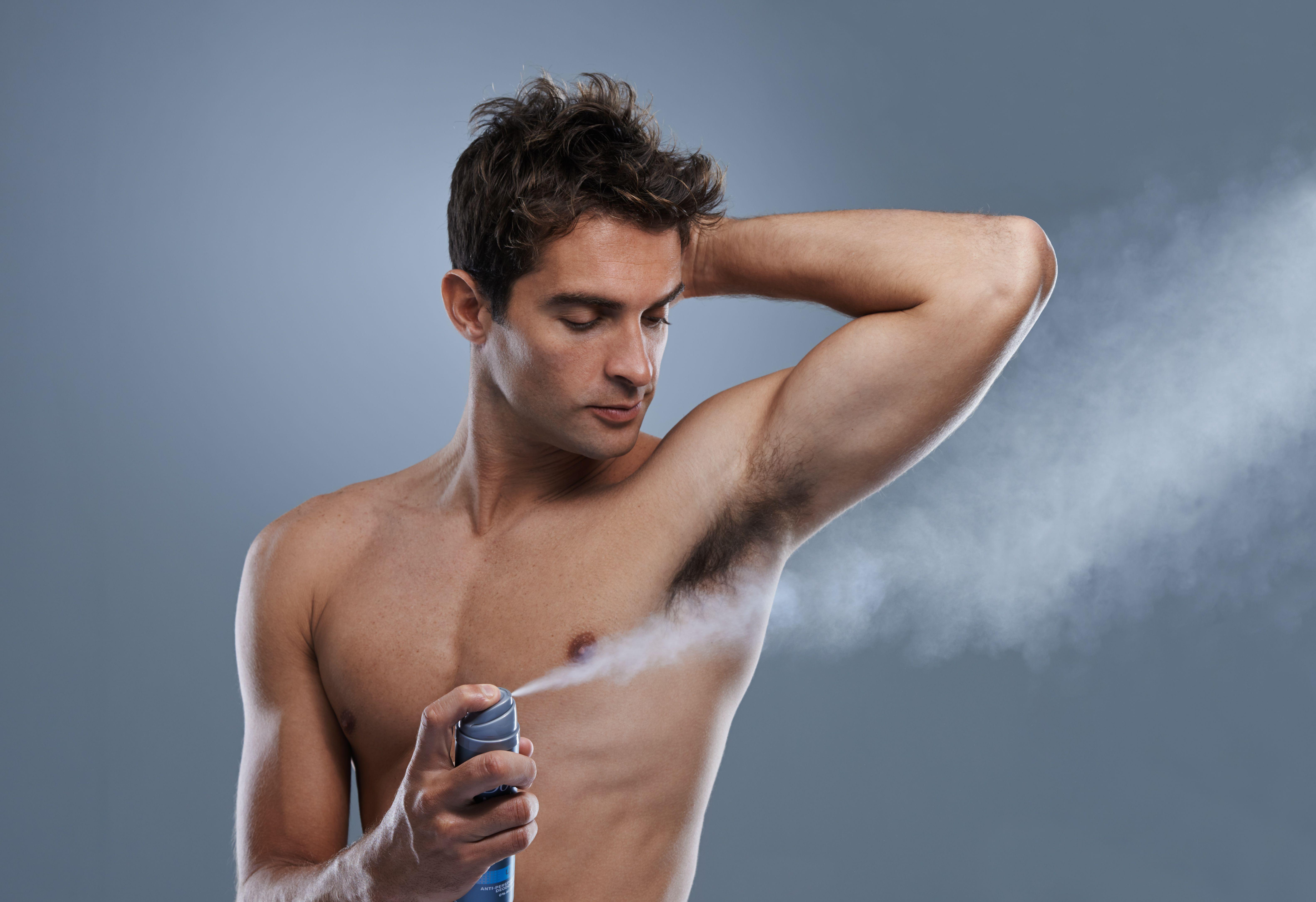 Man applying antiperspirant