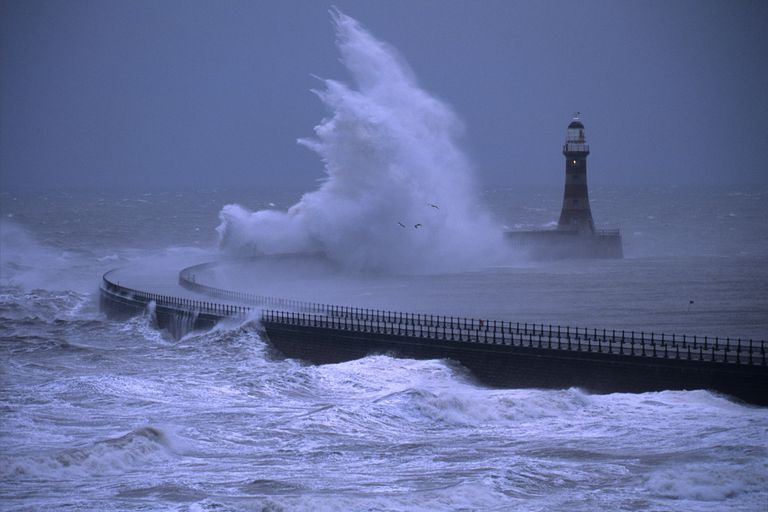 Rough seas breaking over the lighthouse on Roker Pier