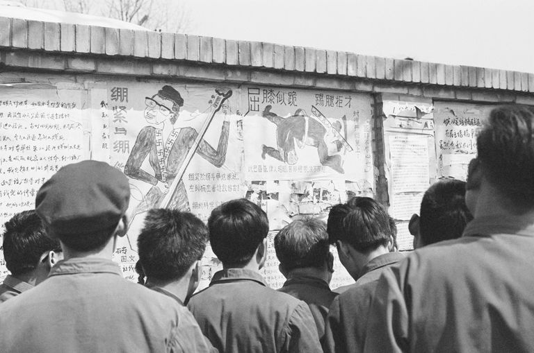 "Beijing residents read posters chastising ""Gang of Four"" on Beijing's ""Democracy Wall,"""