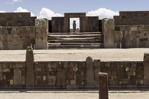 Monolith Ponce viewed through the massive door of Kalasasaya from the Semi-Subterranean Temple, Tiwanaku, Bolivia
