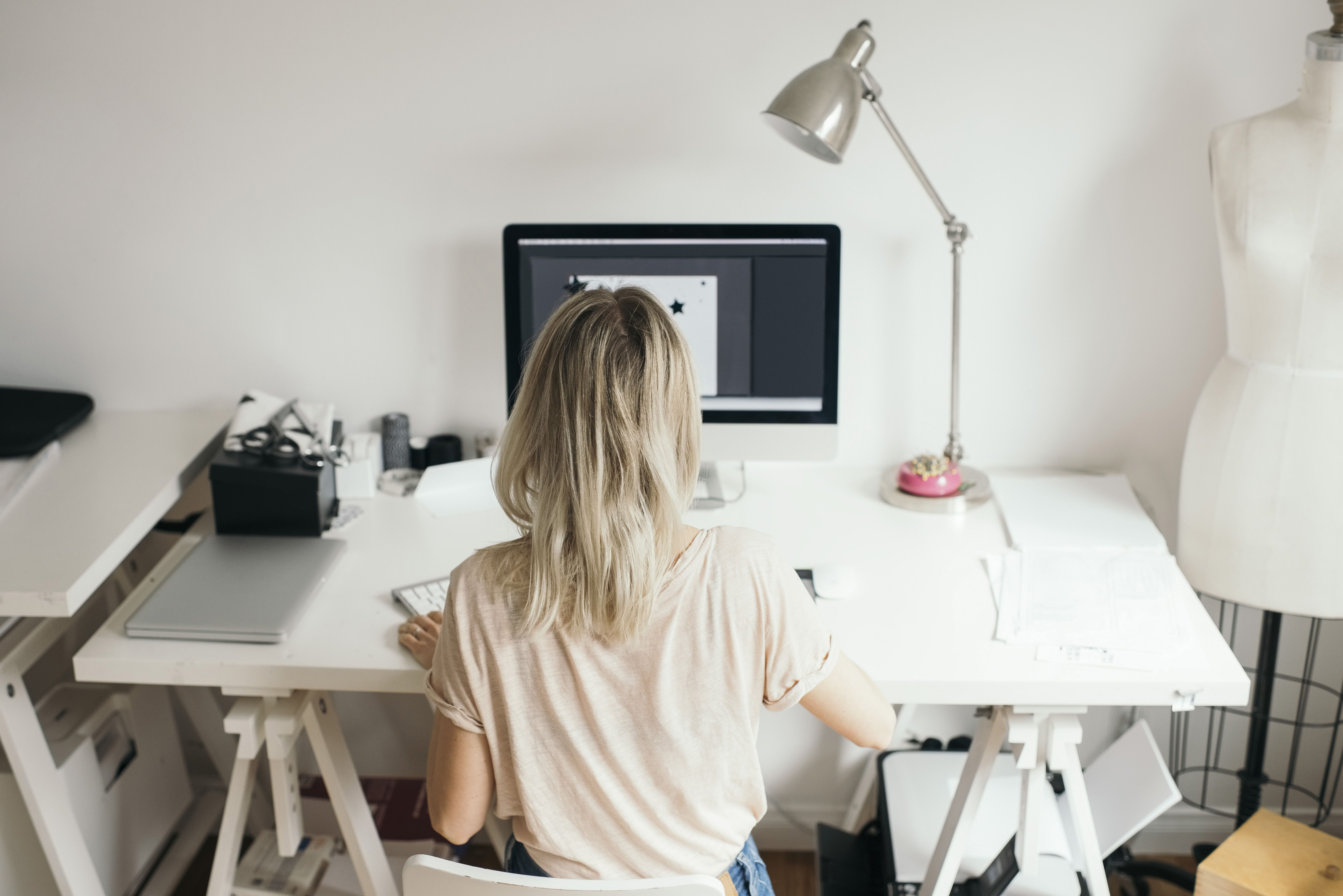 Female design professional using computer at home