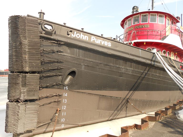 Bow of Tugboat Purves Shows White Load Line Figures on a Black Hull With Red Pilot House