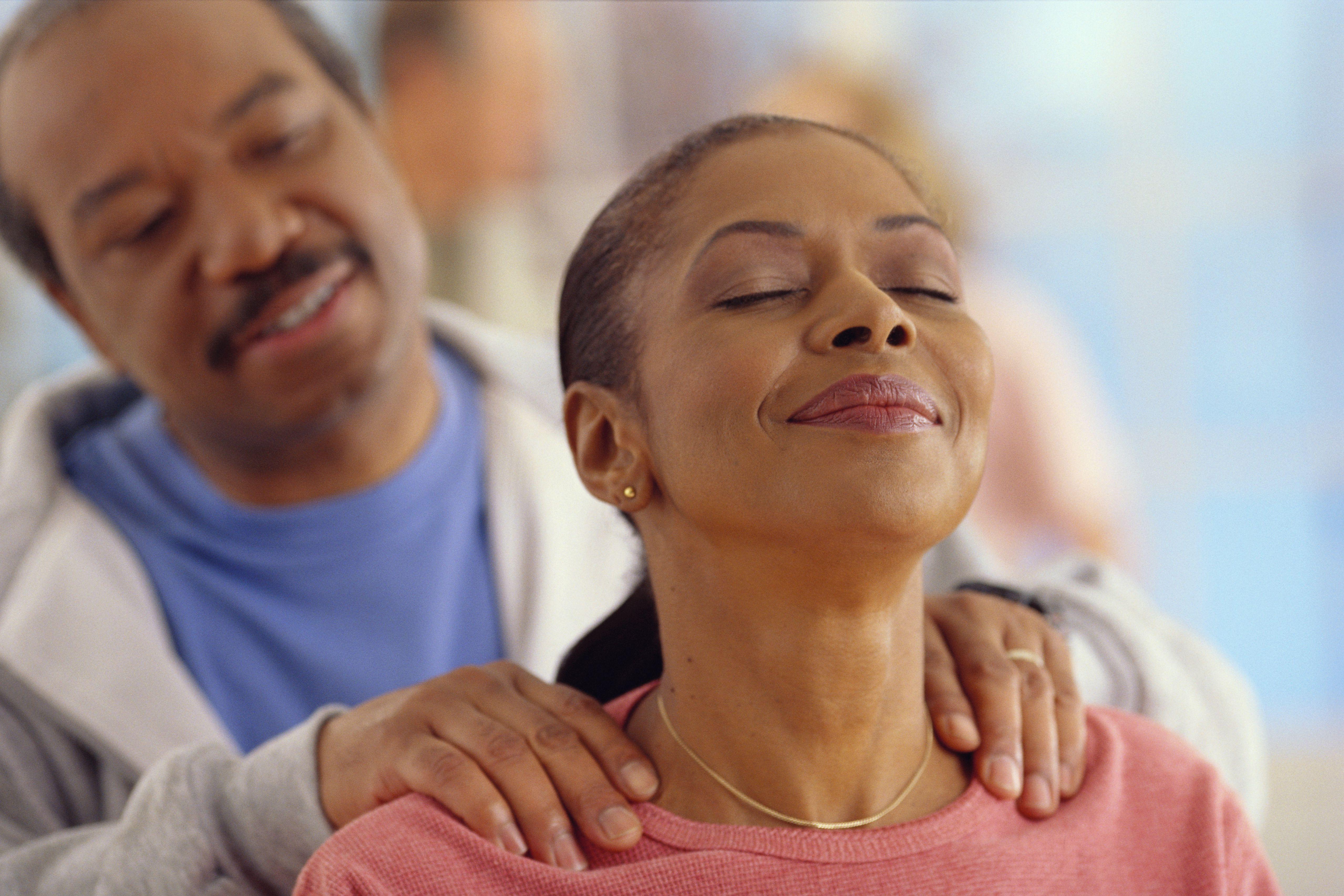 Husband Rubbing Wife's Shoulders