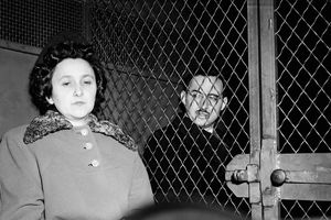 News photograph of Ethel and Julius Rosenberg in police van.