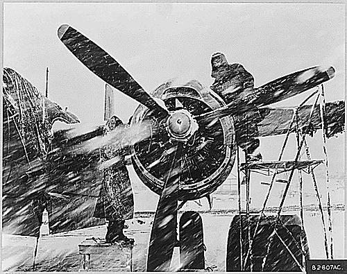 Heavy snow and wind hinders B-26 repairs, Korean War, 1952.