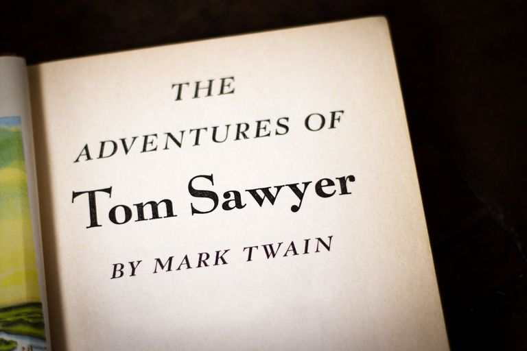 """The Adventures of Tom Sawyer by Mark Twain"" against a black background."