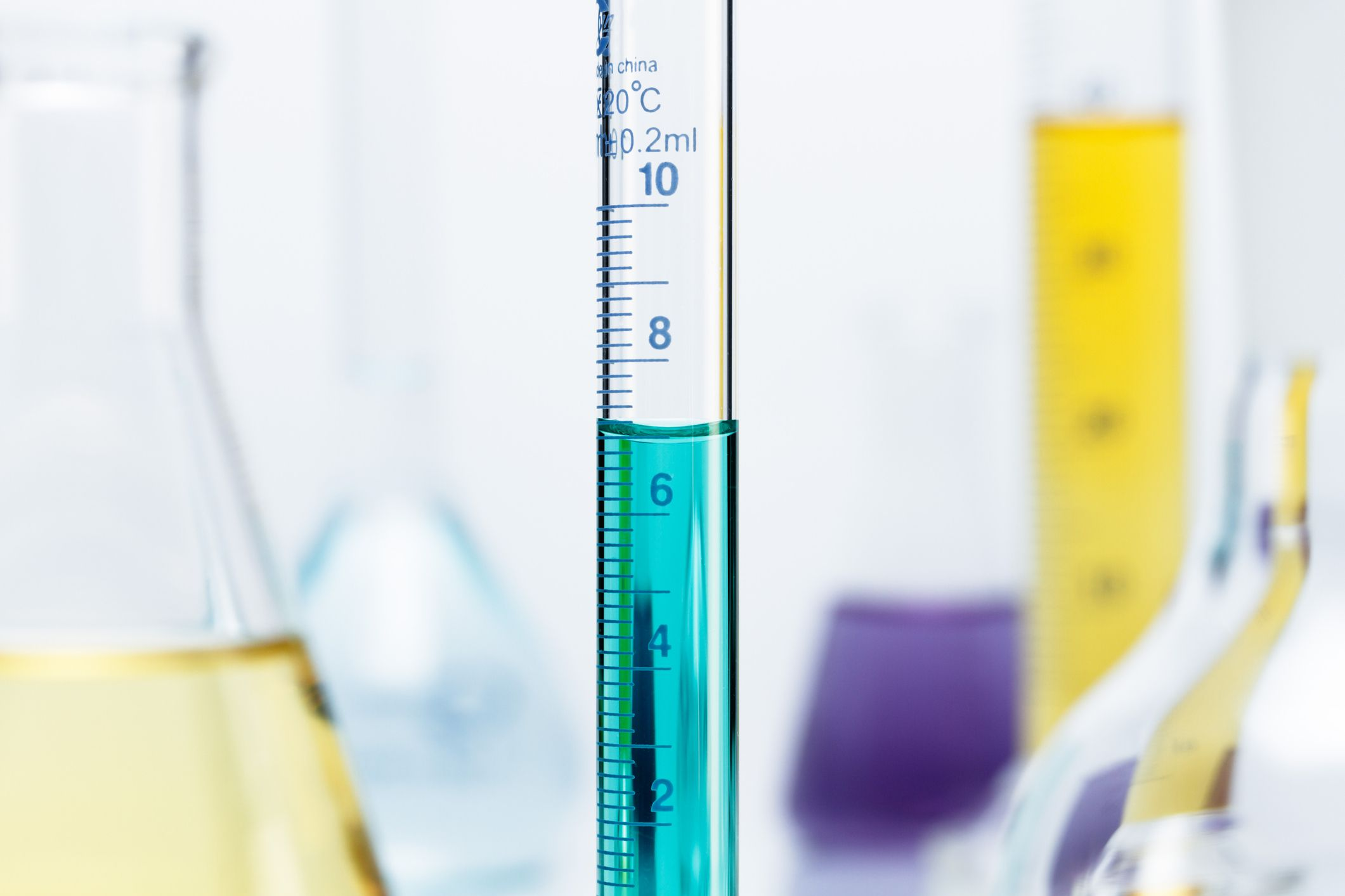 Meniscus of a blue solution in a graduated cylinder