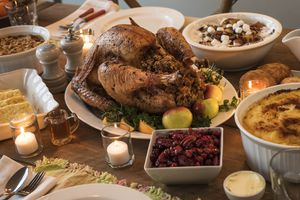 Turkey on a dining room table surrounded by sides