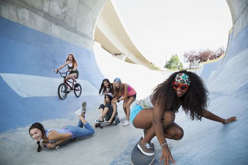 Teenage girls skateboarding