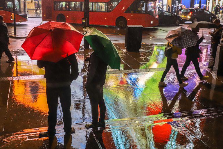 City scene at night in rain