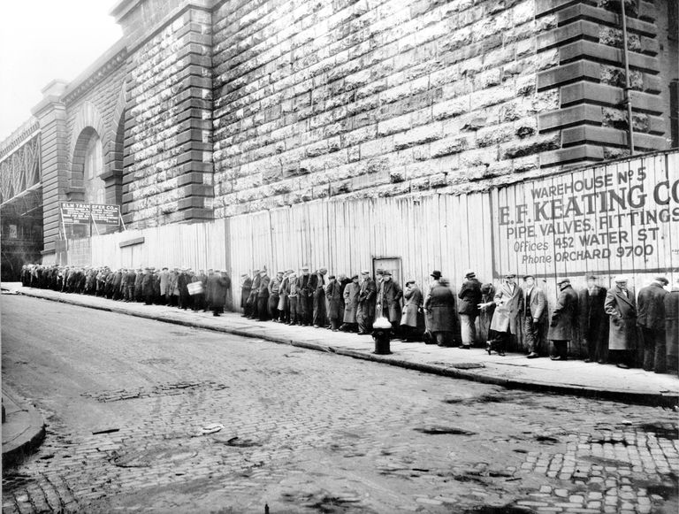 Men Waiting On A Bread Line View of men qu...
