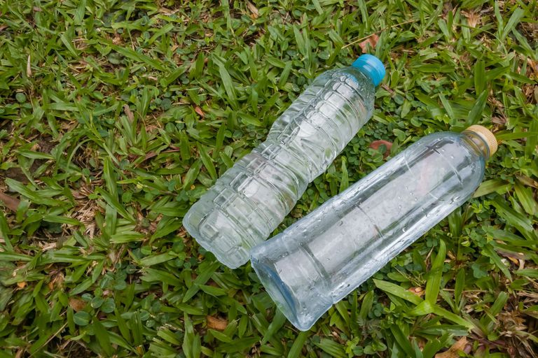 plastic bottles laying in the grass