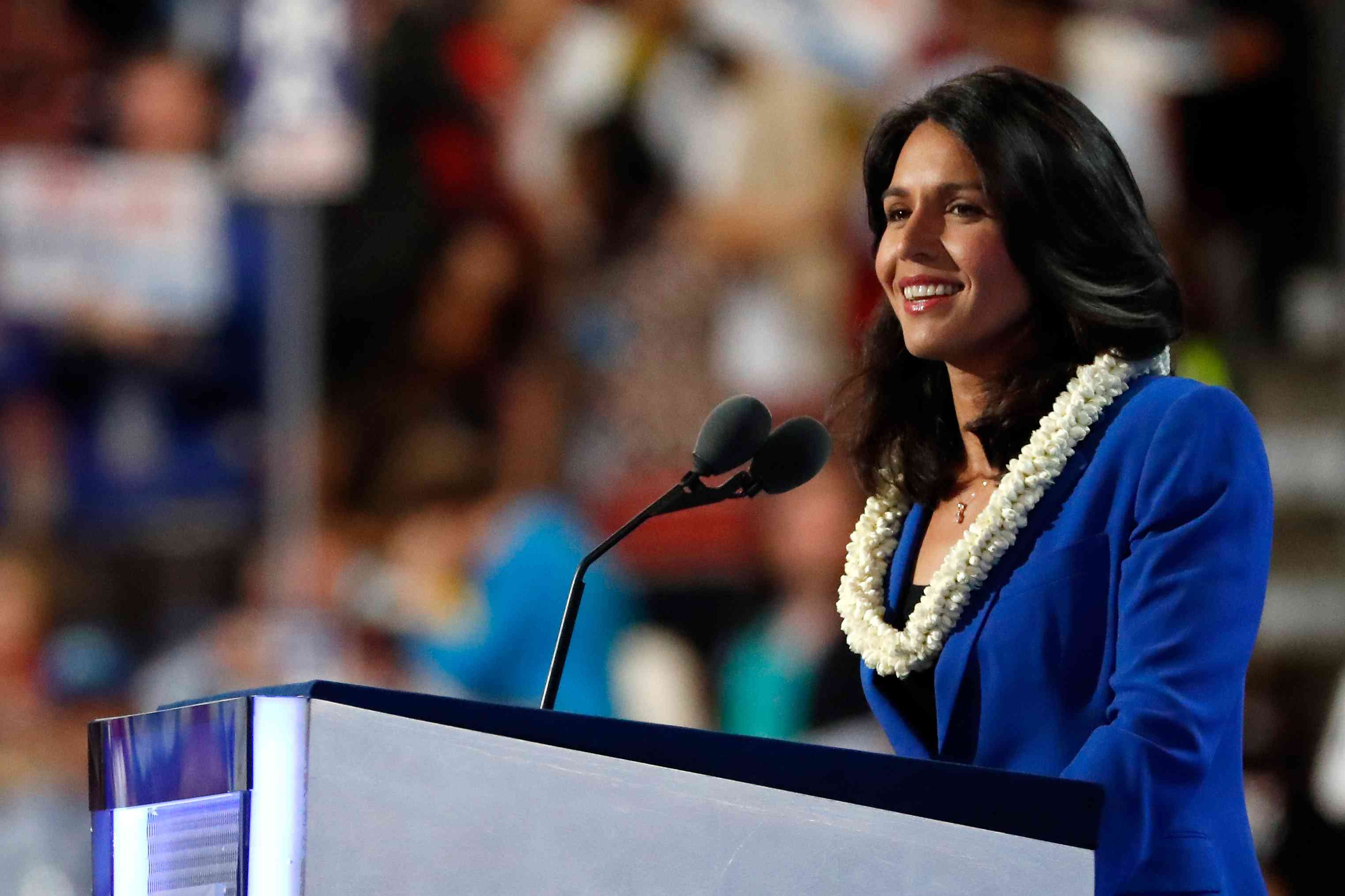 Democratic presidential candidate Tulsi Gabbard standing at a podium
