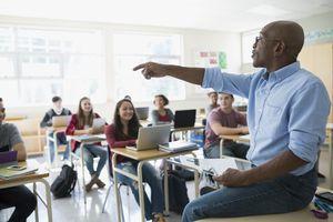 teacher calling on student in classroom