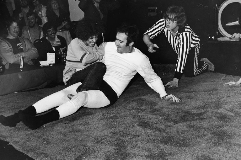 Andy Kaufman wrestling a female competitor