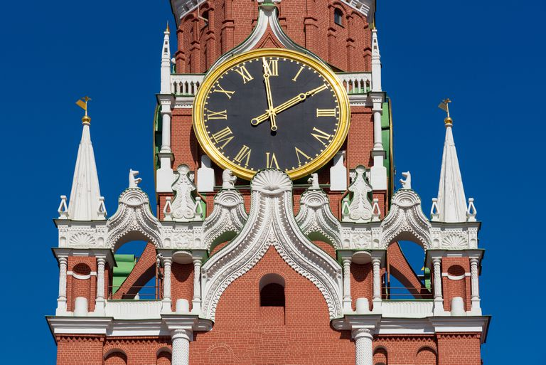 Kremlin Clock on the Spasskaya Tower of Kremlin palace against blue sky in Moscow,Russia